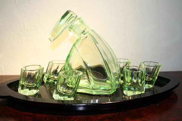 A vintage Art Déco design light green glass liquor carafe pitcher, 6 glasses on a tray