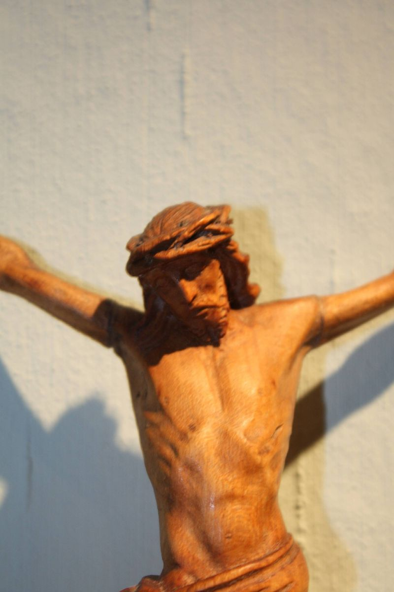 A small antique 19th century hand-carved wooden Jesus Christ figurine