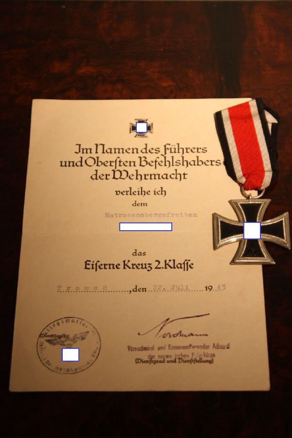 A collection of a German World War 2 sailor's military medals replacement certificates