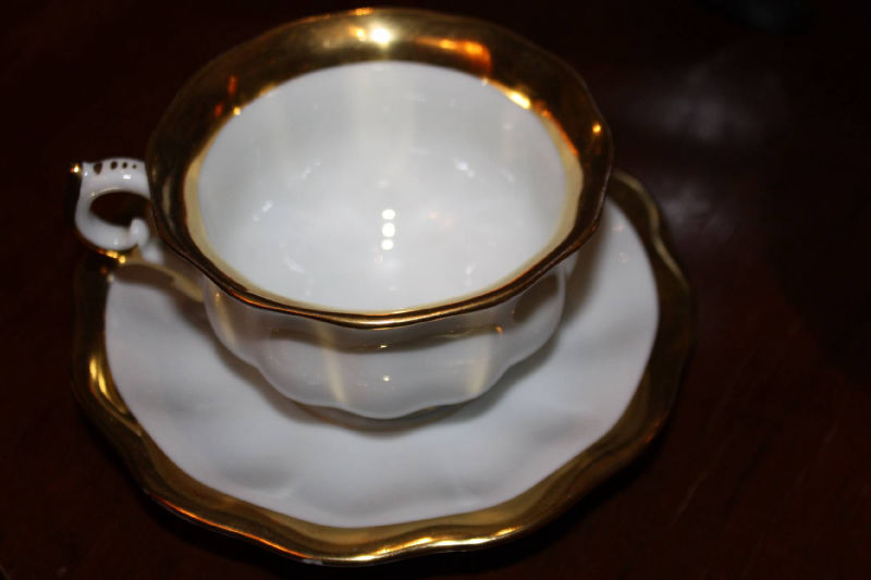 A second half 20th century white and golden tea or coffee serving set by Fuerstenberg, Germany, 10 cups and saucers, 27 parts