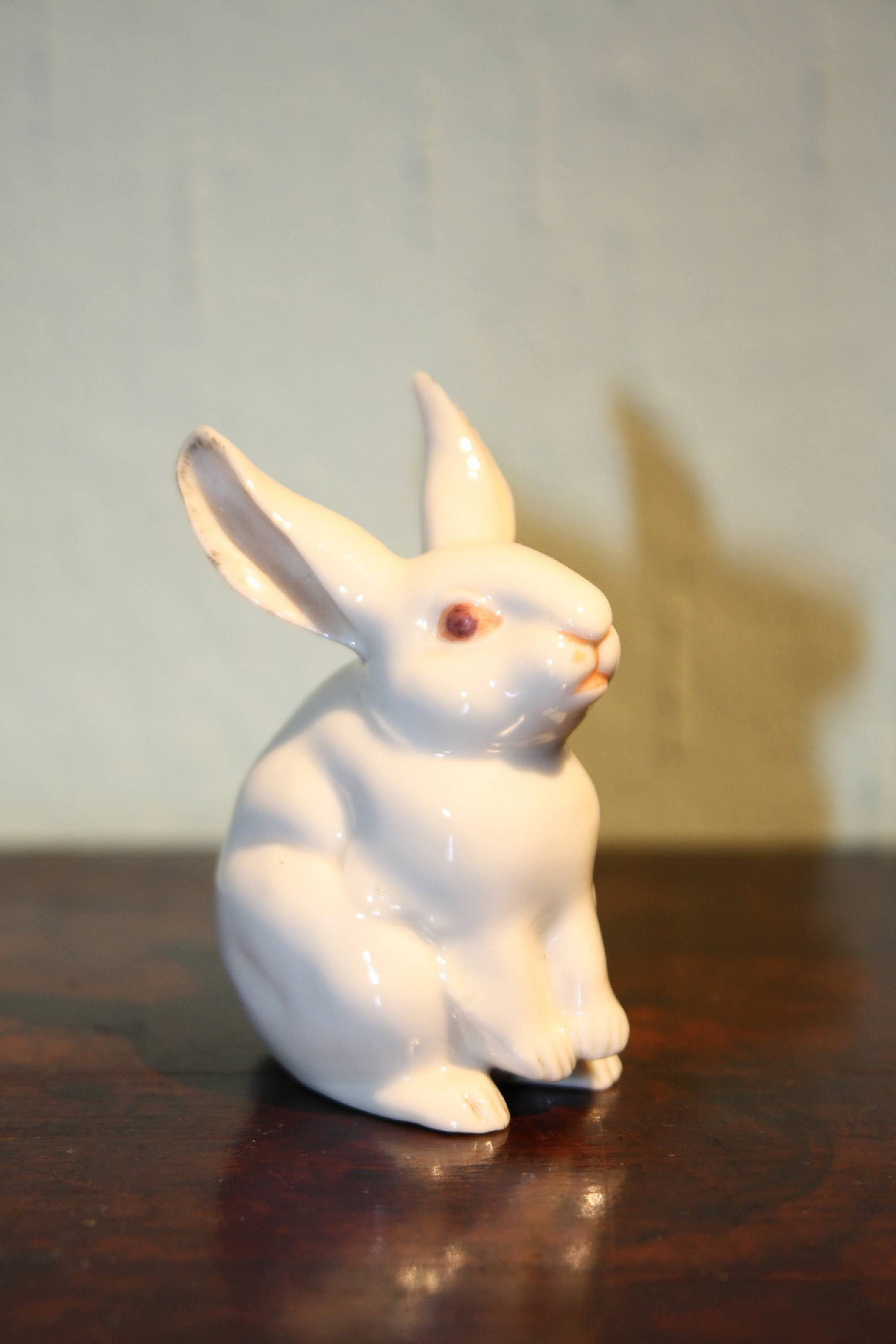 A very small vintage antique 1900 porcelain figurine rabbit by Nymphenburg, Germany
