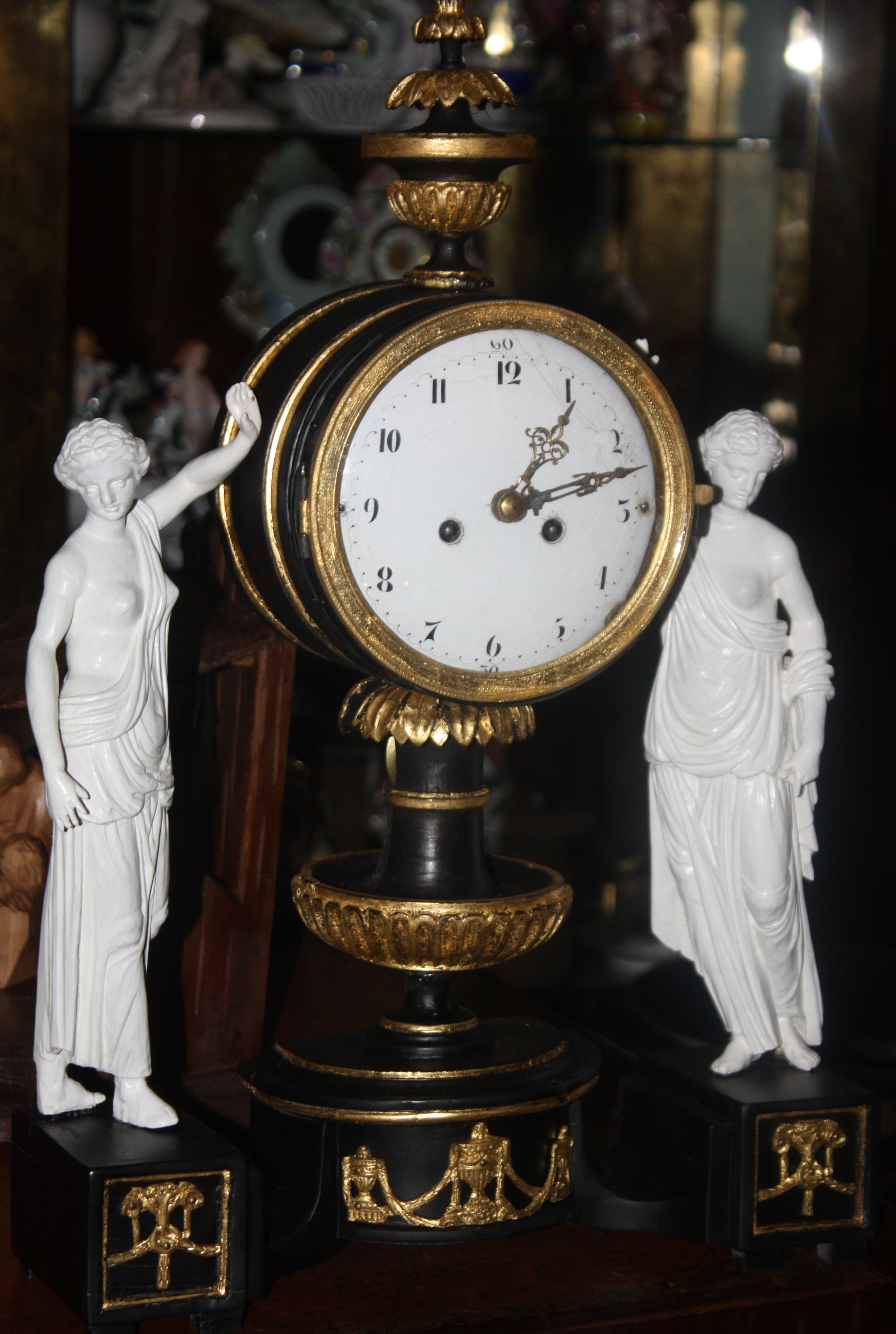 An 1820 Vienna table clock handcarved lime wood case