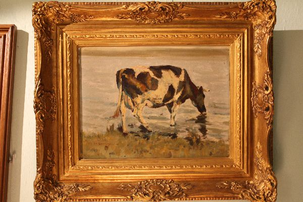 Impressionist early 20th century painting of a drinking cow
