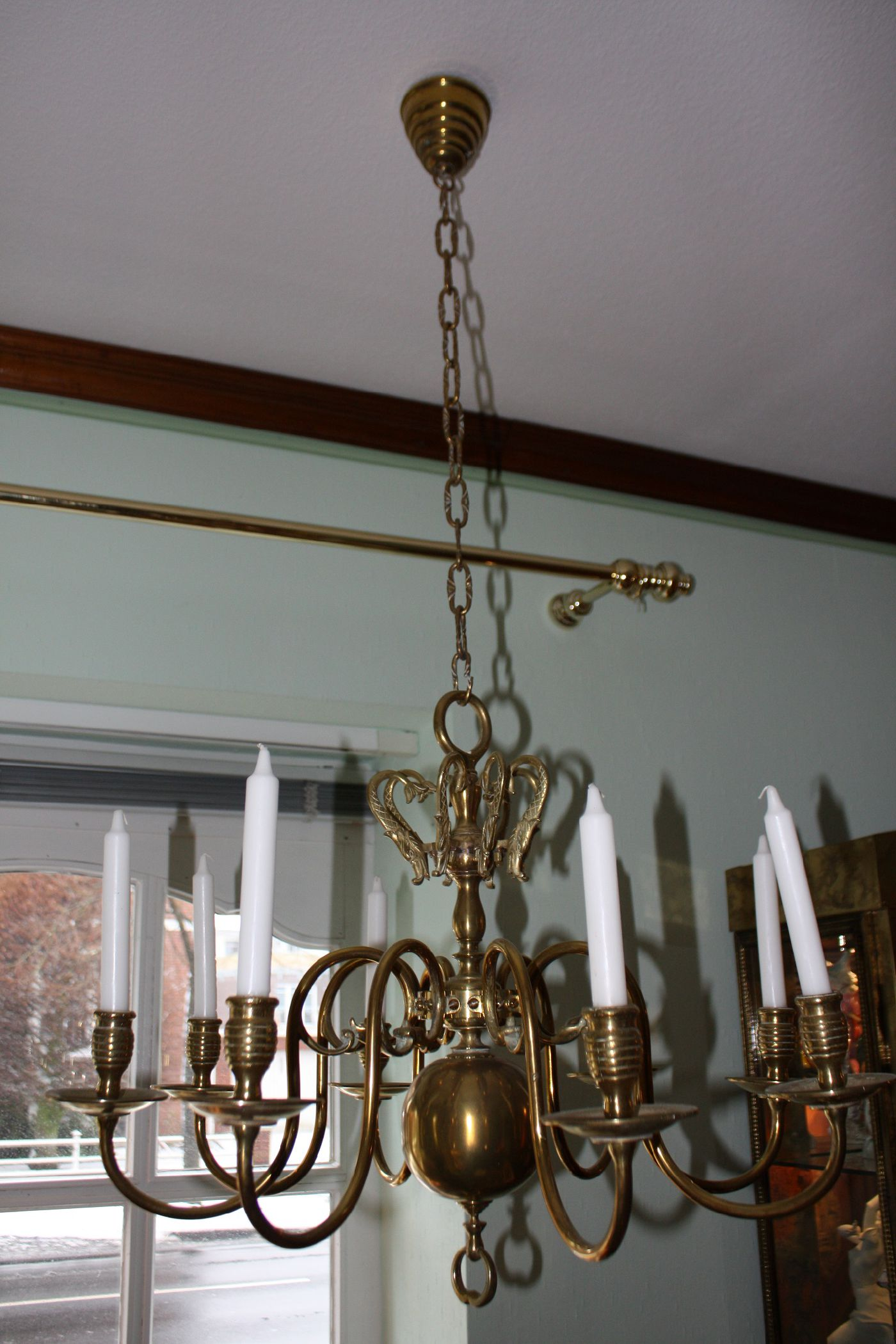 A 19th century flamish or dutch all brass antique chandelier with 8 arms, electrified in the 20th century, in doing so they changed the position of the arms downwards and left the original 8 holders in form of brass fish figurines Size: Diameter: 28.35'' (72 cm)