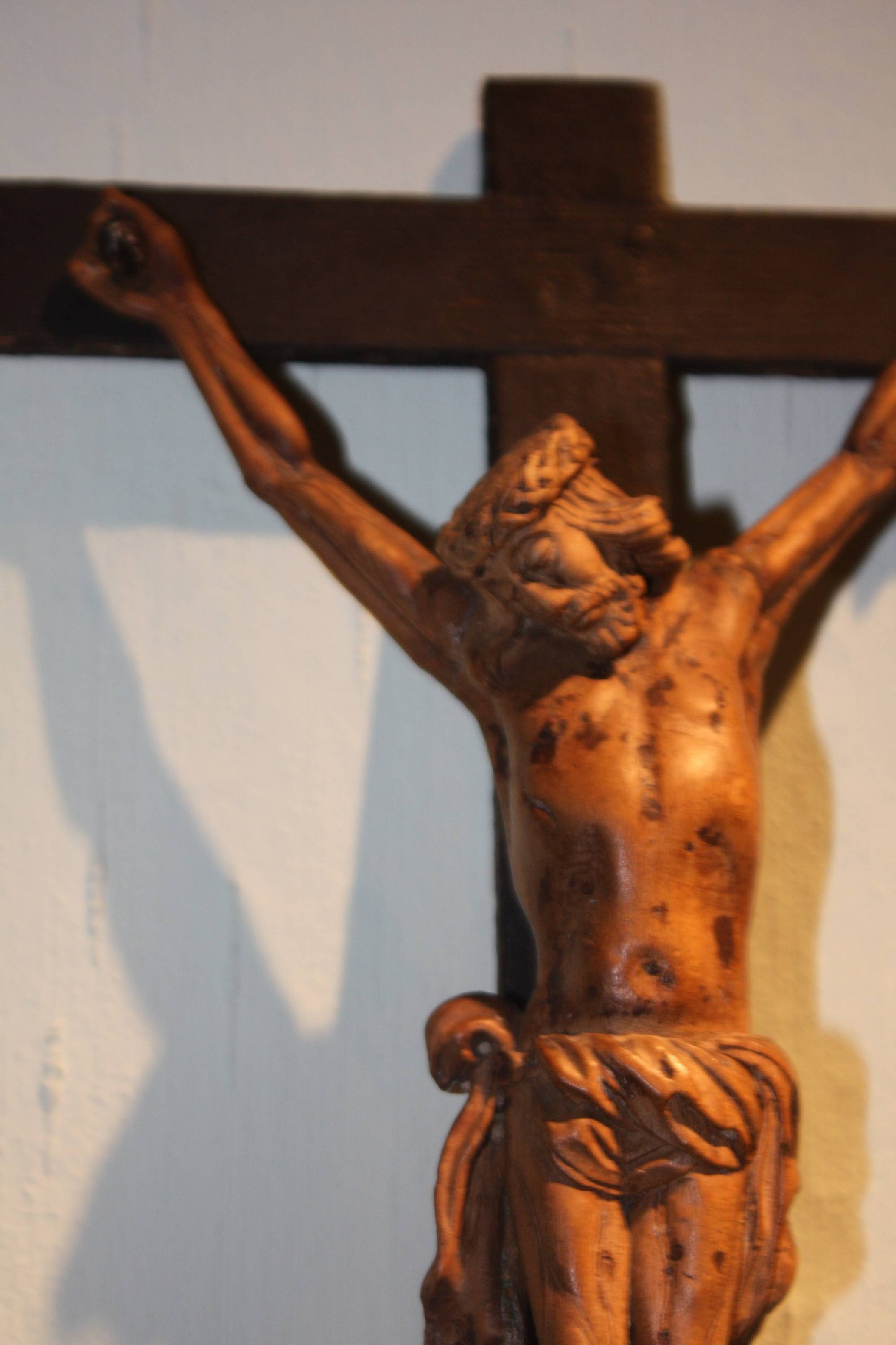 An old 1800 antique wooden handcarved Jesus Christ figure wall cross, crucifix