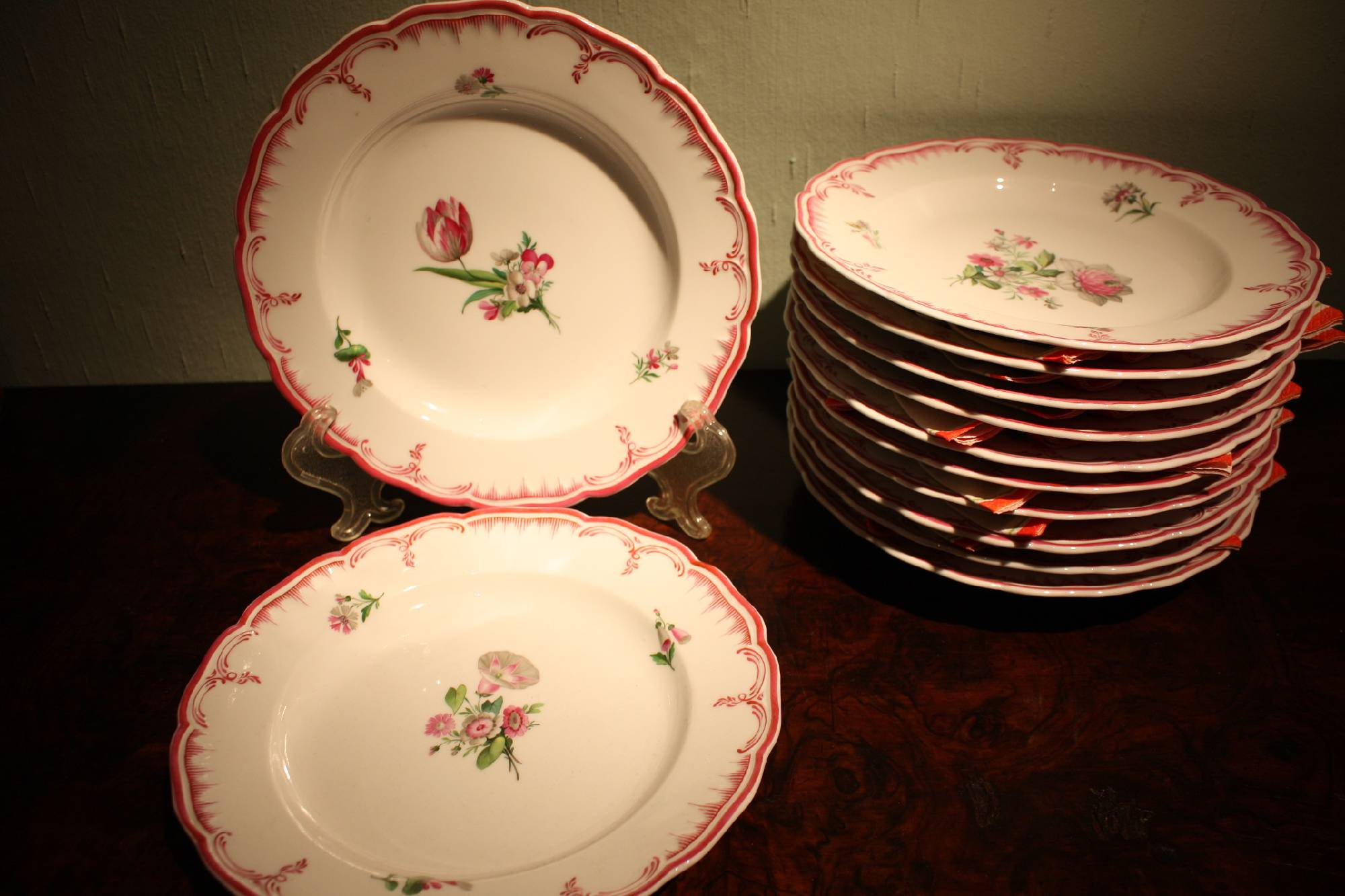 12 Mid-19th century hand-painted porcelain floral ornate KPM Berlin dessert plates