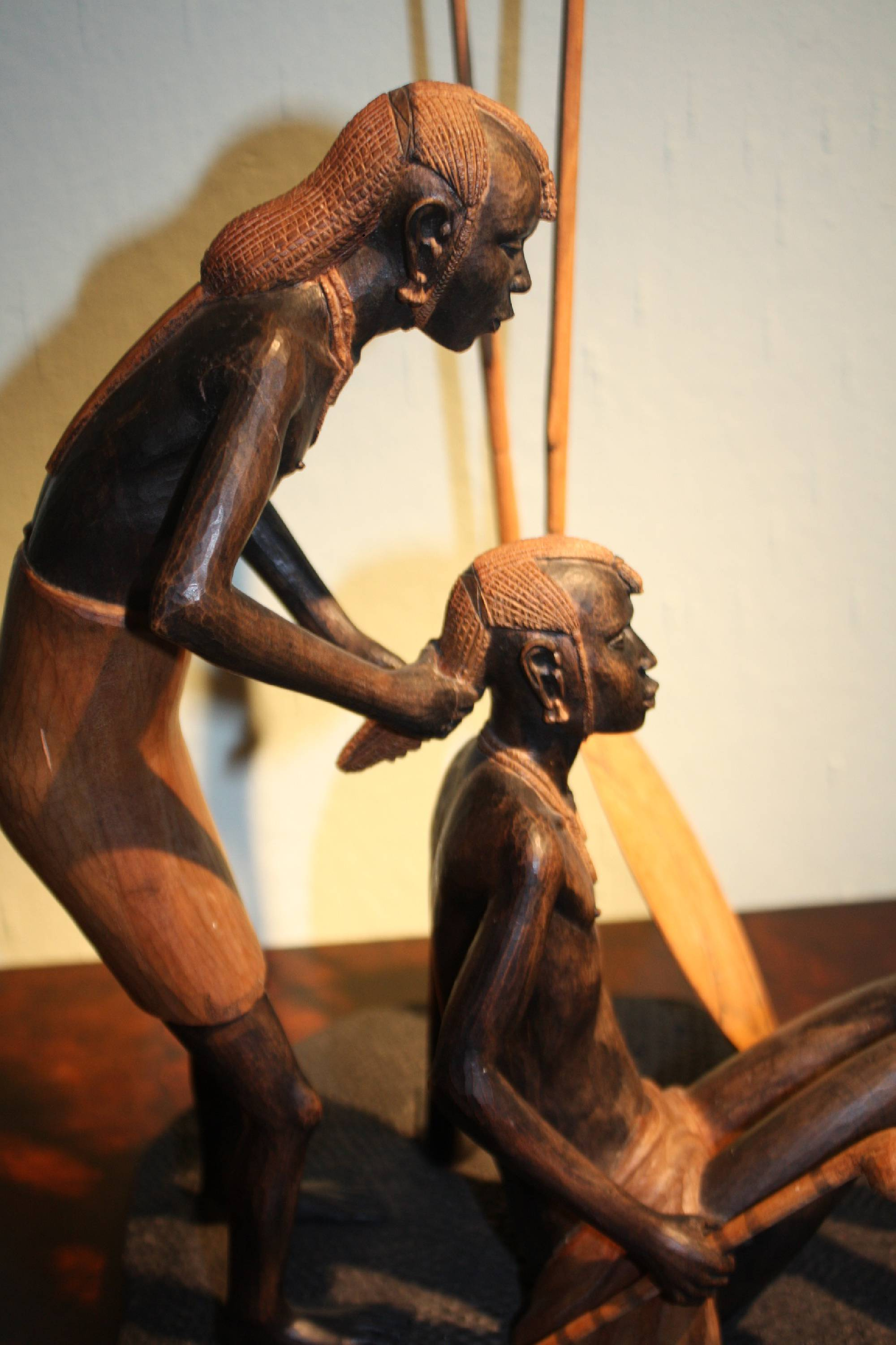 East-African handcarved wooden tribal Massai sculpture showing two hunters