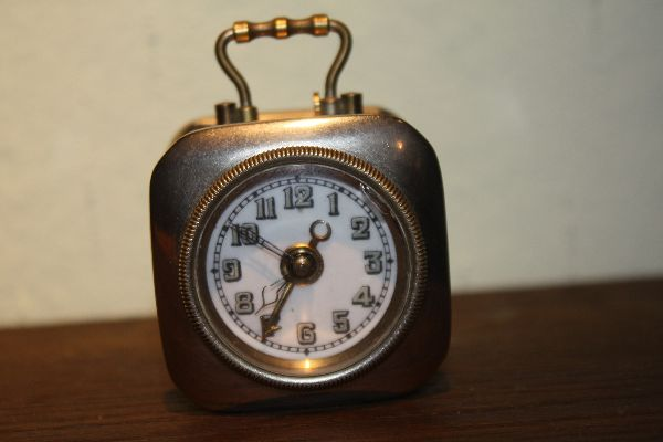 A small vintage metal case travel size alarm clock, Germany 1900, marked 'D.R.P. & G.M.'