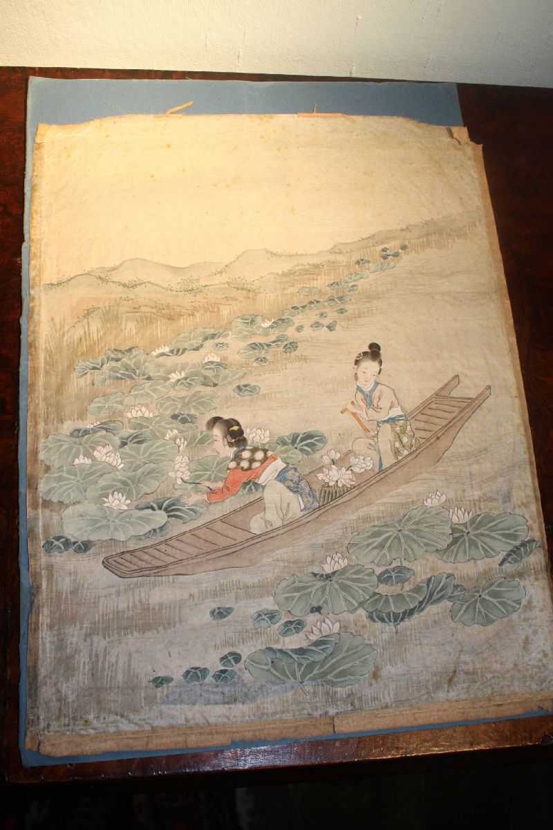 Antique 19th century Asian Japanese silk painting showing two women on a boat collecting lotus flowers