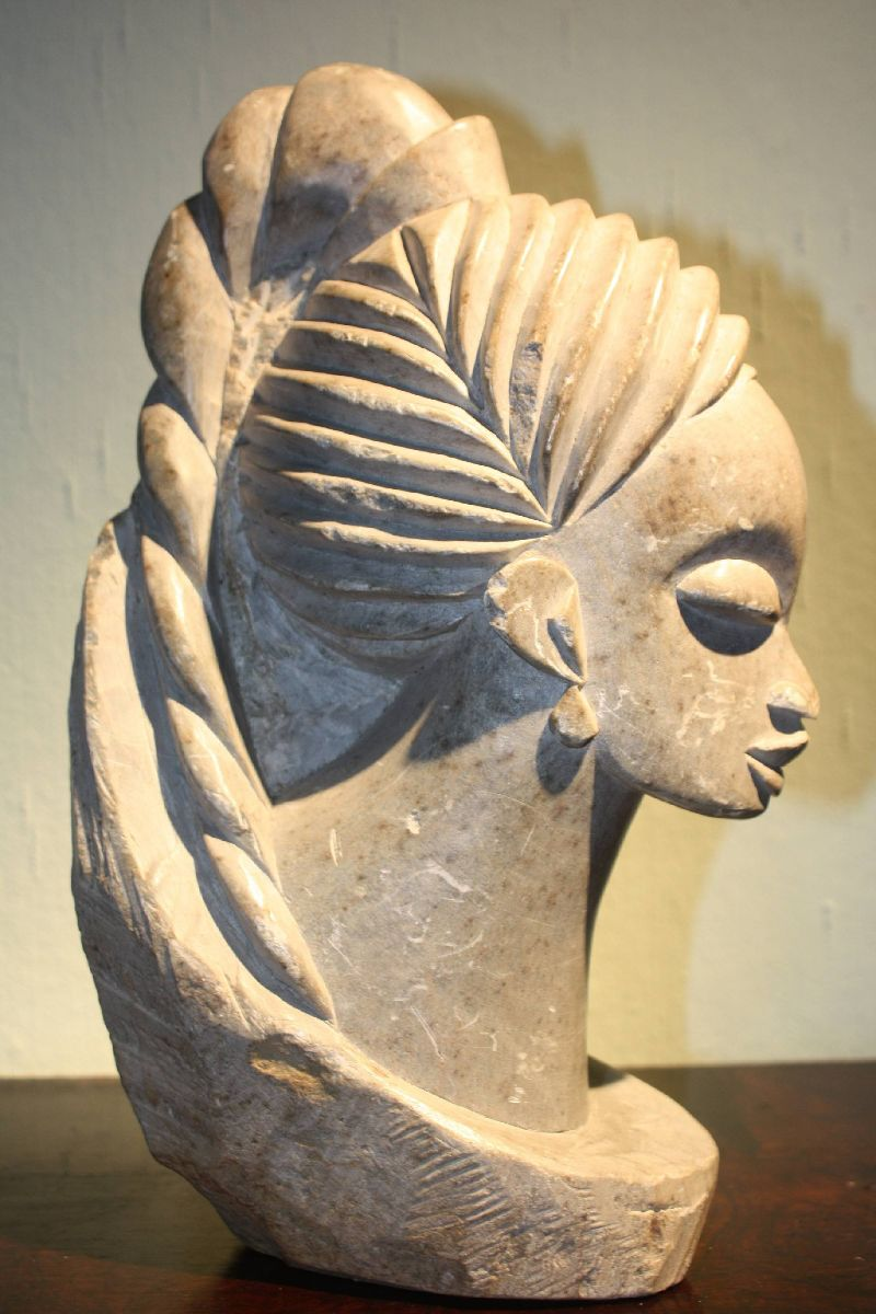 A beautiful African stone sculpture of an African woman