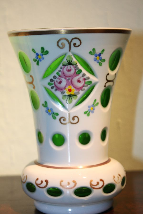A vintage Bohemian 19th century green glass, white milk glass overlay vase