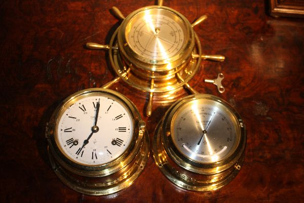 A German set of a brass ship clock, barometer, hygrometer by 'Wempe', Germany